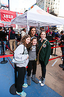 U.S. women national team midfielder Carli Lloyd poses for a photo with fans during the centennial celebration of U. S. Soccer at Times Square in New York, NY, on April 04, 2013.