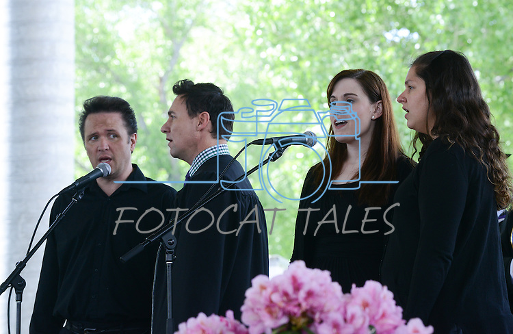 Performers from the Western Nevada Musical Theater Company sing the National Anthem during the 2015 Western Nevada College Commencement held at the Pony Express Pavilion in Carson City, Nev., on Monday, May 18, 2015.<br /> Photo by Tim Dunn