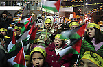 Palestinian children hold Palestinian flag and candles during anniversary of the start of the Fatah movement and Palestinian revolution in the West Bank city of Hebron, December 31, 2009. Photo by Najeh Hashlamoun