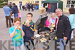 Jim Cadigan and Niall Hurley trying out hot dogs made by Kevin Walsh at the Caherleaheen National School Gadren Fete on Sunday.