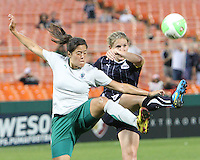 Cat Whitehill #4 of the Washington Freedom kicks high with Madelaine Edlund #19 during a WPS match against St. Louis Athletica on May 1 2010, at RFK Stadium, in Washington D.C.Freedom won 3-1.