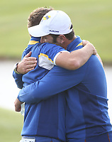 Jon Rahm (Team Europe) hugs Ian Poulter (Team Europe) during Sunday's Singles, at the Ryder Cup, Le Golf National, Île-de-France, France. 30/09/2018.<br /> Picture David Lloyd / Golffile.ie<br /> <br /> All photo usage must carry mandatory copyright credit (© Golffile | David Lloyd)