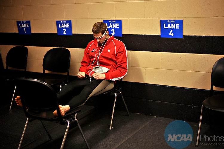 15 MAR 2008:  Marios Panagi, a sophomore from the University of Indianapolis, sits in a waiting room before the start of the men 400 yard freestyle relay during the Division II Swimming and Diving Championship held at the Mizzou Aquatic Center in Columbia, MO.  Panagi and the University of Indianapolis finished the relay in seventh place with a time of 3:02.56..John Tully/NCAA Photos