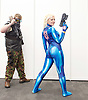 London Super Comic Con<br /> at Design Centre Islington, London, Great Britain <br /> 25th August 2017 <br /> <br /> Samus from Metroid <br /> Fried Fairly from Kent <br /> <br /> and her friend Mad Max (Matt)<br /> <br /> <br /> London Super Comic Con plays host to the latest comics, comic related memorabilia, superheroes and graphic novels fans have a chance to interact with their favourite creators, and  exhibitors showcasing items from comics to Cosplay, original art to toys.<br /> <br /> <br /> <br /> <br /> <br /> <br /> Photograph by Elliott Franks <br /> Image licensed to Elliott Franks Photography Services