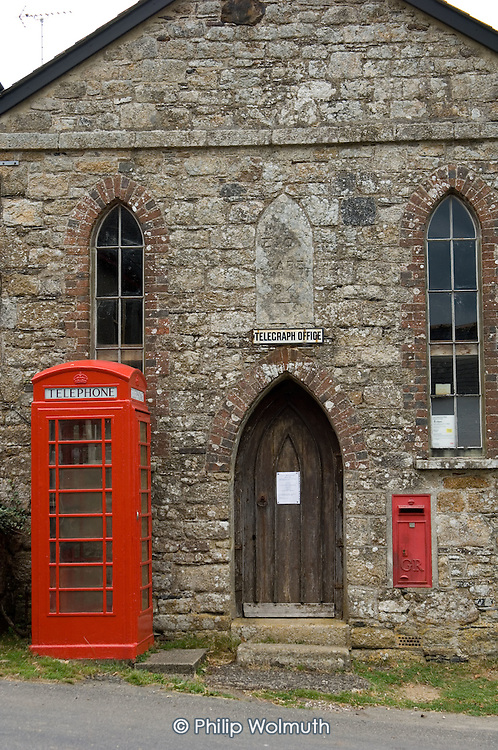 Telephone box outside a Methodist chapel in the Dartmoor village of Belstone.