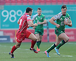 Connacht's Danie Poolman gets away from Scarlets' Steve Shingler<br /> <br /> Rugby - Scarlets V Connacht - Guinness Pro12 - Sunday 15th Febuary 2015 - Parc-y-Scarlets - Llanelli<br /> <br /> &copy; www.sportingwales.com- PLEASE CREDIT IAN COOK