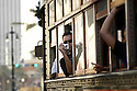 A tourist snaps photos from a streetcar rolling down Canal Street in New Orleans, Monday, January, 2, 2006..(AP Photo/Cheryl Gerber)..
