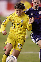 The Columbus Crew's Danny Szetela battles for the ball with Jay Heaps of the New England Revolution. The New England Revolution defeated the Columbus Crew 3 to 0 during the Revolution's MLS home opener at Gillette Stadium, Foxboro. MA, on Saturday April 9, 2005.