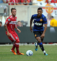 Manchester United midfielder Nani (17) dribbles away from Chicago Fire midfielder Daniel Paladini (11).  Manchester United defeated the Chicago Fire 3-1 at Soldier Field in Chicago, IL on July 23, 2011.