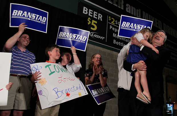 Terry Branstad hoists his granddaughter, Mackenzie, 3, while claiming victory in the Republican primary election Tuesday night, June 8, 2010, at the 7 Flags Event Center in Clive.
