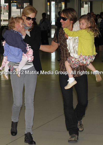 22 June, 2012  Sydney, Australia..NON EXCLUSIVE..Nicole Kidman and husband Keith Urban leave Sydney with Sunday Rose and Faith. Pictured at Sydney International Airport....*No internet without clearance*.MUST CALL PRIOR TO USE ..02 9211-1088.Matrix Media Group.Note: All editorial images subject to the following: For editorial use only. Additional clearance required for commercial, wireless, internet or promotional use.Images may not be altered or modified. Matrix Media Group makes no representations or warranties regarding names, trademarks or logos appearing in the images.