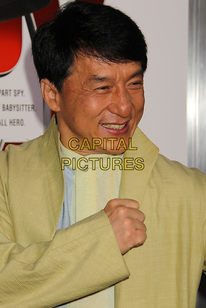 "JACKIE CHAN.""The Spy Next Door"" Los Angeles Premiere held at The Grove, Los Angeles, California, USA, .January 9th, 2010. .headshot portrait shirt jacket hand fist pose gesture suit green yellow white .CAP/ADM/MJ.©Michael Jade/AdMedia/Capital Pictures."