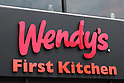 A combined Wendy's and First-Kitchen signboard on display outside its joint fast food restaurant in Ueno on May 24, 2016, Tokyo, Japan. Japanese beverage manufacturer Suntory Holdings Ltd. announced on Monday that it will sell its shares in the First-Kitchen Ltd. hamburger chain to Wendy's Japan LLC. The First-Kitchen chain, which was launched in 1977, operates some 135 outlets in the Tokyo metropolitan area and western Japan and had sales of ¥8.7 billion ($79 million) in 2015. Wendy's plans to keep the First-Kitchen brand after the acquisition and operate joint branded restaurants. (Photo by Rodrigo Reyes Marin/AFLO)