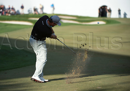 28.02.2016. Palm Beach, Florida, USA.  Graeme McDowell makes a shot at the 18th hole during the final round of the Honda Classic at the PGA National Resort & Spa in Palm Beach Gardens, FL.