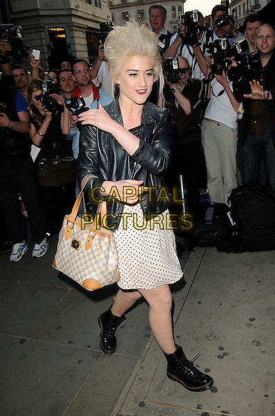 KATIE WAISSEL.At the Pixie Lott for Lipsy Party, Swarovski Crystallized Boutique, London, England, UK, April 21st 2011..full length louis vuitton bag black leather jacket doc martens dms dm boots polka dot white dress hand studded biker .CAP/CAN.©Can Nguyen/Capital Pictures.