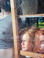 Wigs and t-shirt window display