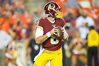 Landover, MD - August 24, 2018: Washington Redskins quarterback Kevin Hogan (8) drops back to throw the ball  during preseason game between the Denver Broncos and Washington Redskins at FedEx Field in Landover, MD. The Broncos defeat the Redskins 29-17. (Photo by Phillip Peters/Media Images International)
