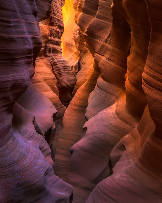 A dazzling display of reflected light on sandstone pillars in this remote slot canyon of the Arizona desert.