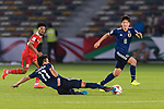 Kitagawa Koya of Japan (L) passes the ball to teammate Haraguchi Genki of Japan (R) during the AFC Asian Cup UAE 2019 Group F match between Oman (OMA) and Japan (JPN) at Zayed Sports City Stadium on 13 January 2019 in Abu Dhabi, United Arab Emirates. Photo by Marcio Rodrigo Machado / Power Sport Images