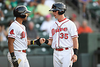 Right fielder Granger Studdard (35) of the Greenville Drive is greeted by Tyler Hill (7) after scoring a run in a game against the Kannapolis Intimidators on Wednesday, July 12, 2017, at Fluor Field at the West End in Greenville, South Carolina. Greenville won, 12-2. (Tom Priddy/Four Seam Images)