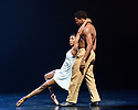 """London, UK. 15.03.2018. Ballet Black presents a double bill of """"The Suit"""", choreographed by Cathy Marston, and """"A Dream Within A Midsummer Night's Dream"""", choreographed by Arthur Pita, in the Barbican theatre. Shown here is: """"The Suit"""". Picture shows: Cira Robinson (Matilda), Mthuthuzeli November (Simon). Photograph © Jane Hobson."""