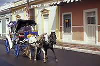 Horse-drawn carriage and restored Spanish colonial houses in Granada, Nicaragua, Central America
