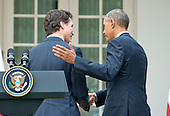 United States President Barack Obama, right, and Prime Minister Justin Trudeau of Canada, left, shake hands as they depart a joint press conference in the Rose Garden of the White House in Washington, DC on Thursday, March 10, 2016. <br /> Credit: Ron Sachs / CNP