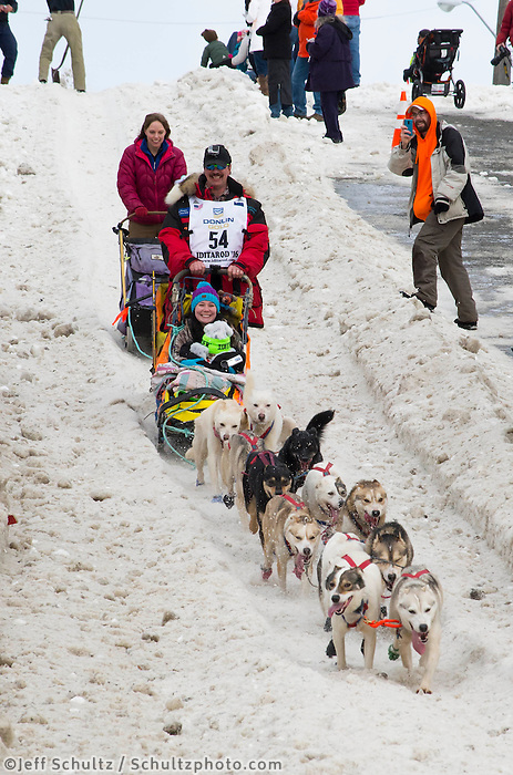 Alan Eischens and team run past spectators on the bike/ski trail with an Iditarider in the basket during the Anchorage, Alaska ceremonial start on Saturday, March 5, 2016 Iditarod Race. Photo by O'Hara Shipe/SchultzPhoto.com