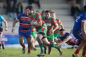 Ben Thornton makes a run downfield past Sione Tu'ipulotu. Counties Manukau Premier Club Rugby game between Waiuku and Ardmore Marist, played at Waiuku on Saturday June 4th 2016. Ardmore Marist won 46 - 3 after leading 39 - 3 at Halftime. Photo by Richard Spranger.
