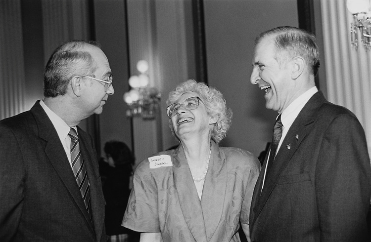After his swear-in Rep. Sam Johnson, R-Tex., and wife Shirley Johnson share laugh with Sen. Phil Gramm, R-Tex., at the Cannon Caucus Room at a reception on May 23, 1991. (Photo by Maureen Keating/CQ Roll Call via Getty Images)