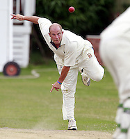 Alex Greig bowls for Wembley during the Middlesex County Cricket League Division Three game between North London and Wembley at Park Road, Crouch End on Sat Aug 2, 2014