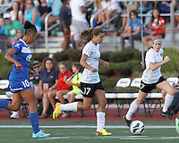 Portland Thorns FC midfielder Tobin Heath (17) brings the ball forward.  In a National Women's Soccer League (NWSL) match, Boston Breakers (blue) defeated Portland Thorns FC (white/black), 2-1, at Dilboy Stadium on August 7, 2013.