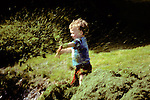 Boy Playing With Grass
