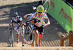 October 17, 2015 - Boulder, Colorado, U.S. - Elite cyclist, Emily Kachorek, shoulders her bike on the long run-up during the U.S. Open of Cyclocross, Valmont Bike Park, Boulder, Colorado.