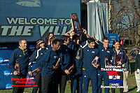 Caleb Hoover, Coach Eric Heins-far left, formerly of Southeast Missouri State University, and the rest of the Northern Arizona cross country squad raise their Men's 4th place trophy at the 2012 NCAA Division I Cross Country Championships, Saturday, November 17, at E.P. Tom Sawyer State Park in Louisville, KY.