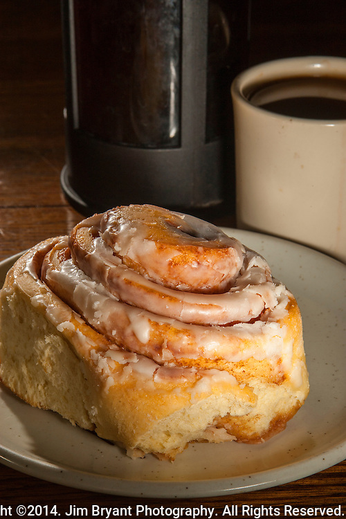 "Cafe Gabielle's ""Peggy's Cinnamon Roll"" with French pressed freshly grounded Ethiopian Harrar coffee . ©2014. Jim Bryant Photography. All Rights Reserved."