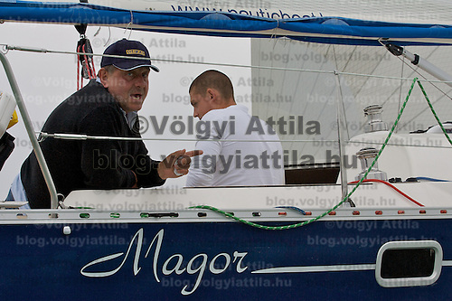 0807181021a Hungarian celebrity Sandor Fabry posing for photographers just woke up from his sleap after start on board the Nautica class ship Geze-Magor. 40th Blue Ribbon Regatta race with 570 participating yachts sailing the 160 km course around Lake Balaton near Balatonfured. Hungary. Friday, 18. July 2008. ATTILA VOLGYI