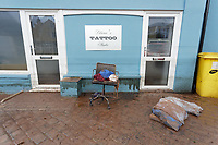 Pictured: Items destroyed by the flood are left outside a tattoo parlour.<br /> Re: Cleanup after storm Dennis in Crickhowell, Wales, UK.