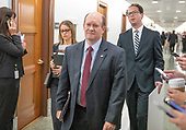 United States Senator Chris Coons (Democrat of Delaware) arrives to hear the testimony of Dr. Christine Blasey Ford  before the US Senate Committee on the Judiciary on the nomination of Judge Brett Kavanaugh to be Associate Justice of the US Supreme Court to replace the retiring Justice Anthony Kennedy on Capitol Hill in Washington, DC on Thursday, September 27, 2018.<br /> Credit: Ron Sachs / CNP<br /> (RESTRICTION: NO New York or New Jersey Newspapers or newspapers within a 75 mile radius of New York City)