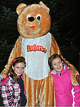 Lily Ann Faulkner and Shannon Bowden pictured with the Gummy Bear at the opening of the Bonanza Festival and the switching on of the christmas lights. Photo: Colin Bell/pressphotos.ie