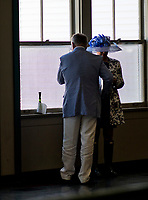 LOUISVILLE, KY - MAY 06: A man and a woman look out of a window on Kentucky Derby Day at Churchill Downs on May 6, 2017 in Louisville, Kentucky. (Photo by Douglas DeFelice/Eclipse Sportswire/Getty Images)