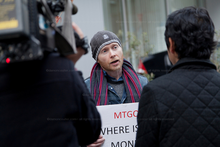 Bitcoin trader, Kolin Burges, from the United Kingdom, talks to the press as he protests in front of the abandoned offices of Tokyo-based Bitcoin exchange, Mt. Gox. Shibuya, Tokyo, Japan. Friday February 28th 2014. Mr Burges flew to Japan to personally confront the trading company over his inabilty to withdraw over 260,000 USD worth of the electronic currency. Mt. Gox officially filed for bankruptcy protection on February 28th 2014