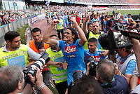 Napoli's Edinson Cavani ( C), lorenzo Insigne( R) and Paolo Cannavaro (L) celebrates victory and the qualification of the SSC Napoli team in the UEFA Champions League during the Italian Serie A football match between SSC Napoli and Siena at the San Paolo stadium in Naples.NAPOLI CACIO FESTA QUALIFICAZIONE  CHAMPIONS