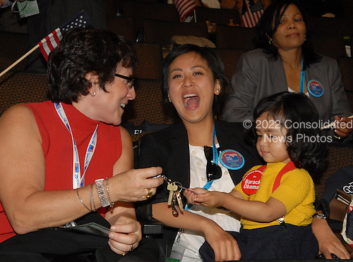 Denver, CO - August 25, 2008 -- Liz Abzug, left, and Grace Yu, center, entertain 2 year-old Maia Yu, all of Manhattan, New York, in the New York Delegation on Day 1 of the 2008 Democratic National Convention at the Pepsi Center in Denver, Colorado on Monday, August 25, 2008..Credit: Ron Sachs - CNP.(RESTRICTION: NO New York or New Jersey Newspapers or newspapers within a 75 mile radius of New York City)