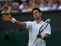 01-07-13, England, London,  AELTC, Wimbledon, Tennis, Wimbledon 2013, Day seven, Novak Djokovic (SRB) is frustrated<br /> <br /> <br /> <br /> Photo: Henk Koster