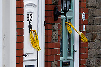 Pictured: Remnants of yellow cordon warning of the danger still hangs off front doors in Oxford Street. Monday 17 February 2020<br /> Re: Cleanup after storm Dennis in Oxford Street, Nantgarw, Wales, UK.