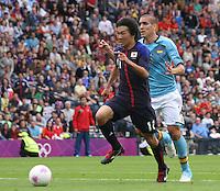 Men's Olympic Football match Spain v Japan on 26.7.12...Kensuke Nagai of Japan and Oriol Romeu of Spain, during the Spain v Japan Men's Olympic Football match at Hampden Park, Glasgow...........