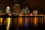 Austin skyline at night across Ladybird Lake.