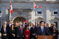 Justin Trudeau, Canada new  Prime Minister and his new cabinet adress the medias  on the grounds of Rideau Hall in Ottawa, Ontario, on Wednesday, November 4, 2015.<br /> <br /> PHOTO : Pierre Roussel<br /> - Agence Quebec Presse