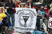 UK Uncut ad Disabled People Against the Cuts block the road outside the Royal Courts of Justice in protest at proposed cuts to Legal Aid.